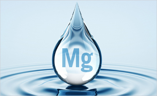 A large water drop with the periodic table symbol fro Magnesium inside of it.